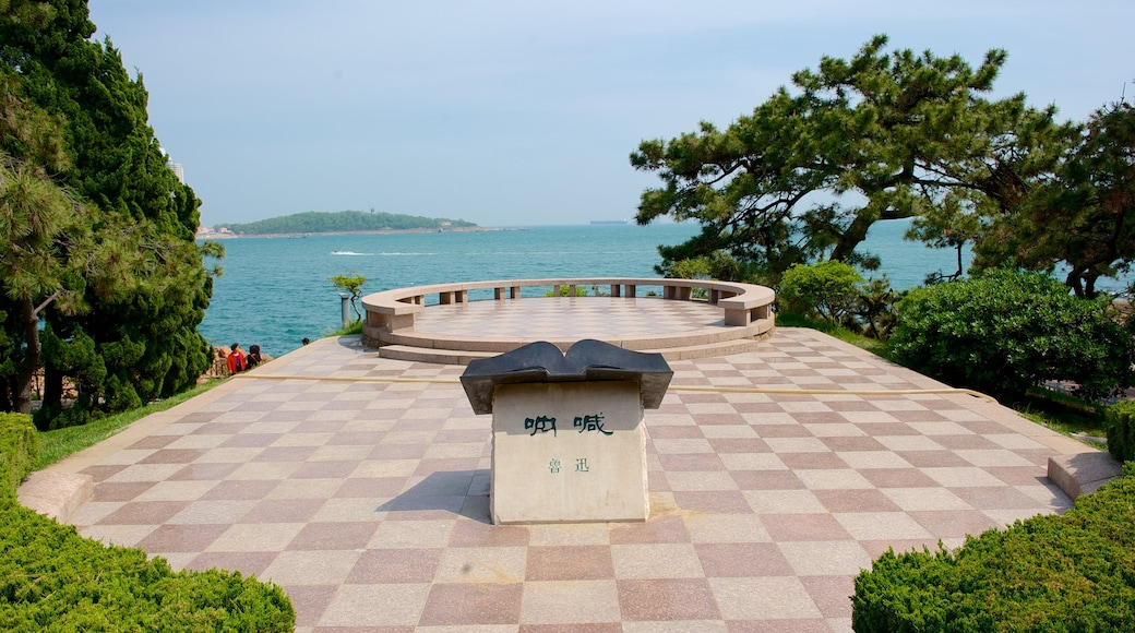 Lu Xun Park featuring outdoor art and a monument