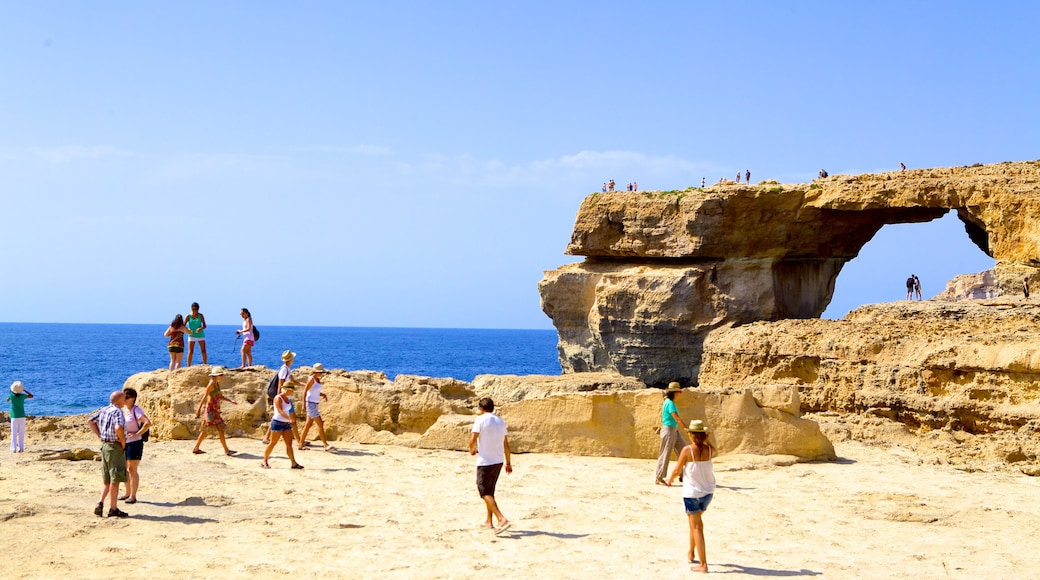 Azure Window showing rugged coastline as well as a large group of people