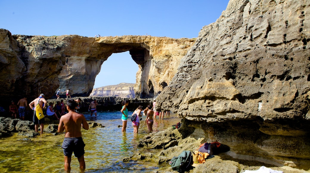Azure Window which includes rugged coastline as well as a small group of people