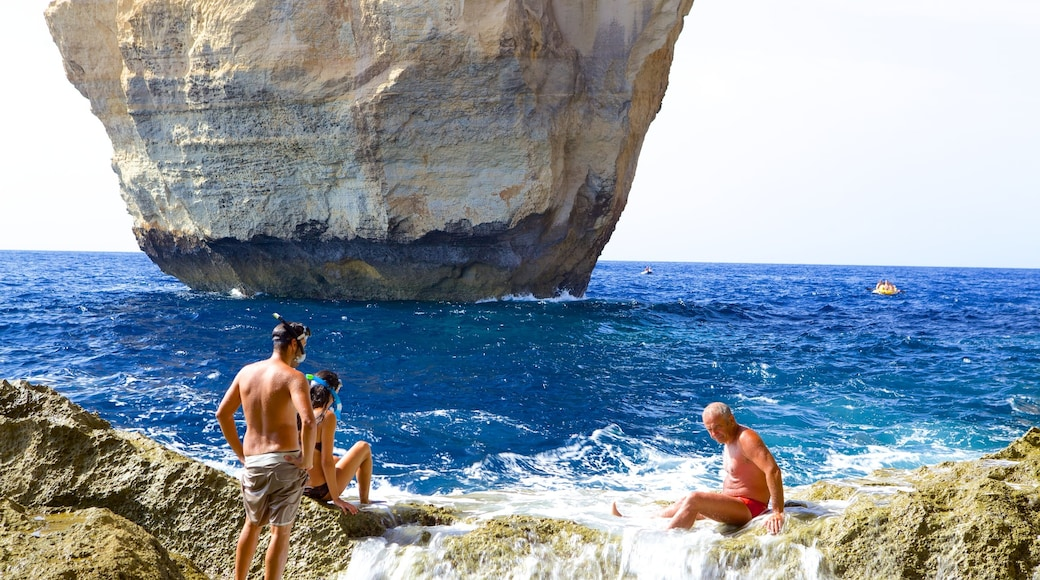 Azure Window featuring rugged coastline as well as a small group of people