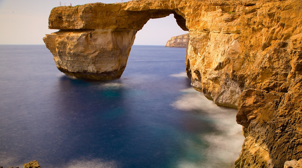 Azure Window featuring rugged coastline and a sunset