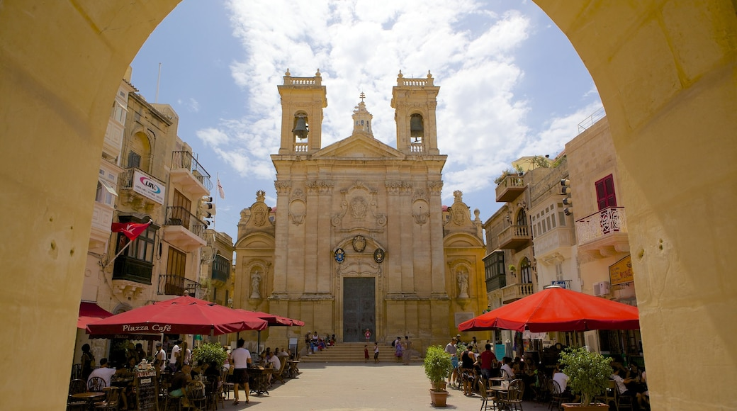 St. George\'s Basilica which includes a church or cathedral, heritage architecture and a square or plaza
