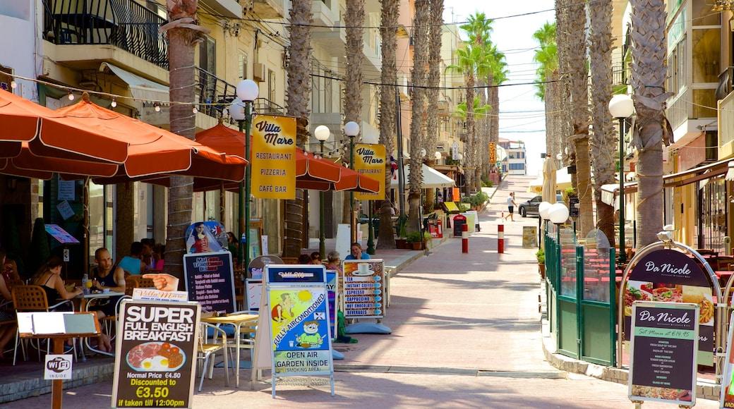 Plage de Bugibba mettant en vedette pause café, sortie au restaurant et scènes de rue