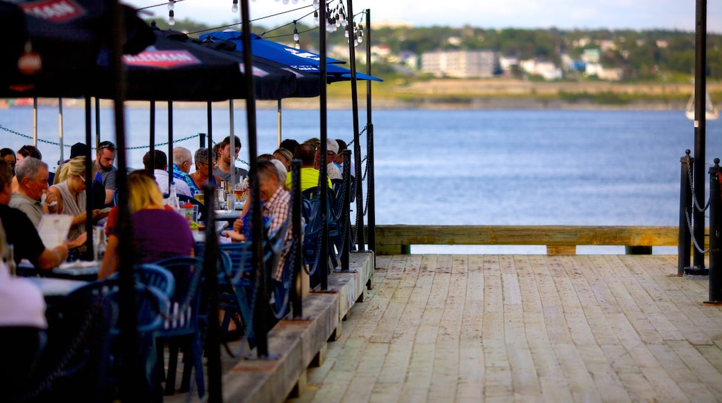 Halifax Waterfront Boardwalk which includes outdoor eating and a coastal town as well as a large group of people