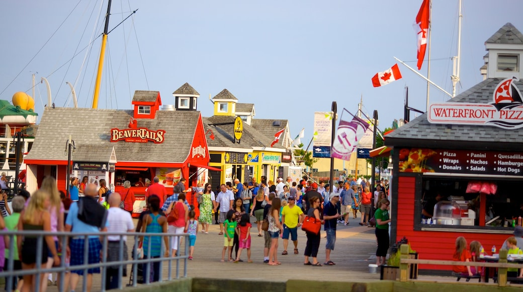 Halifax Waterfront Boardwalk which includes signage, a coastal town and a small town or village