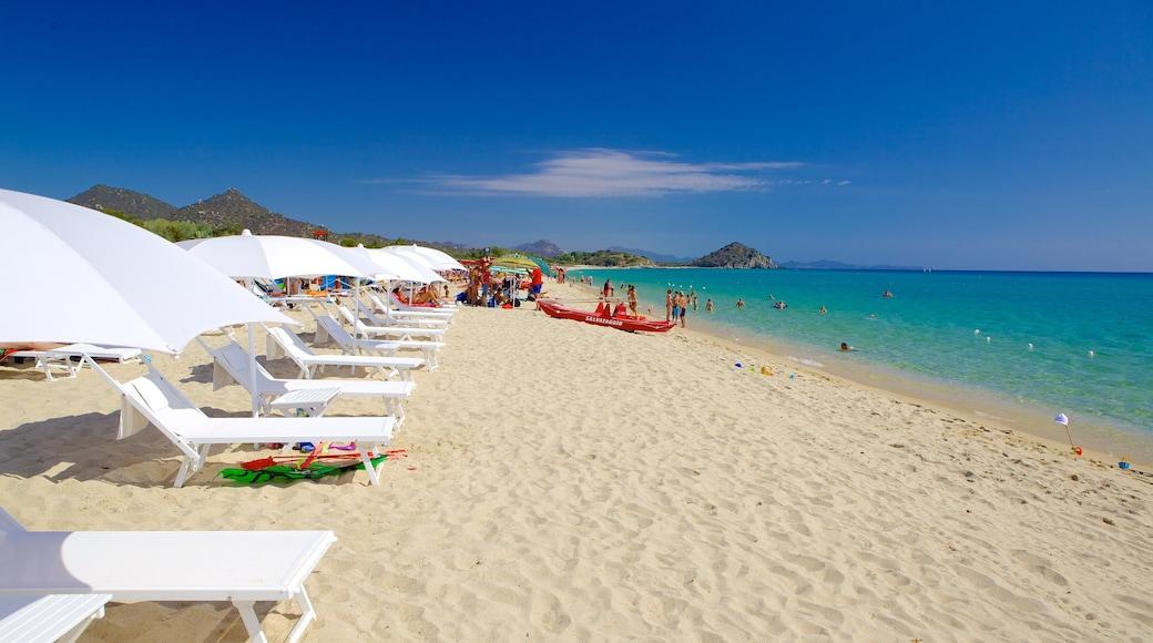 Cala Sinzias which includes a sandy beach and general coastal views