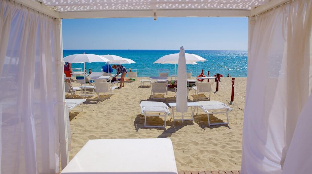 Cala Sinzias featuring a beach