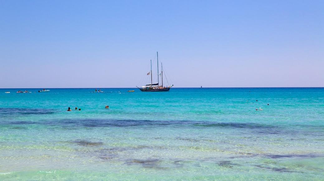 Playa Simius mostrando natación, vistas generales de la costa y vistas de paisajes