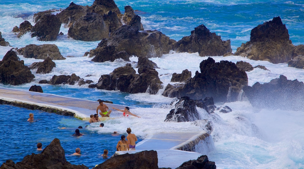 Porto Moniz Natural Pools featuring a pool and rugged coastline