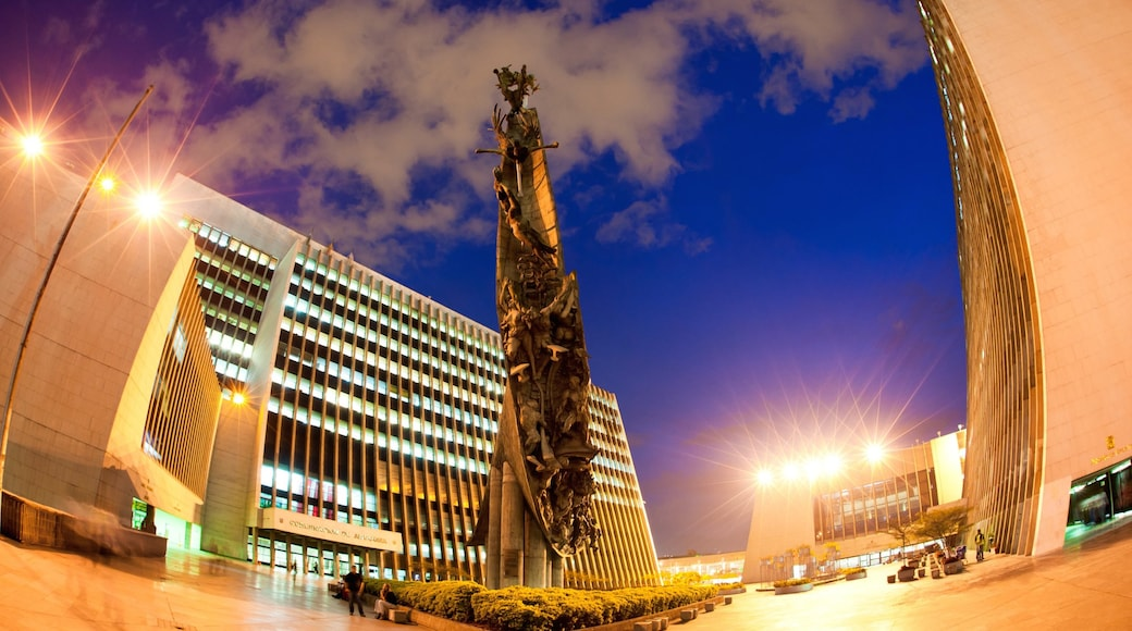 Medellin showing night scenes, a square or plaza and outdoor art