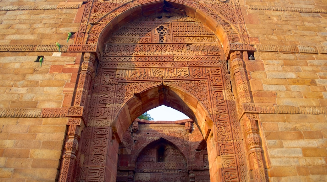 Qutub Minar featuring heritage architecture and a temple or place of worship