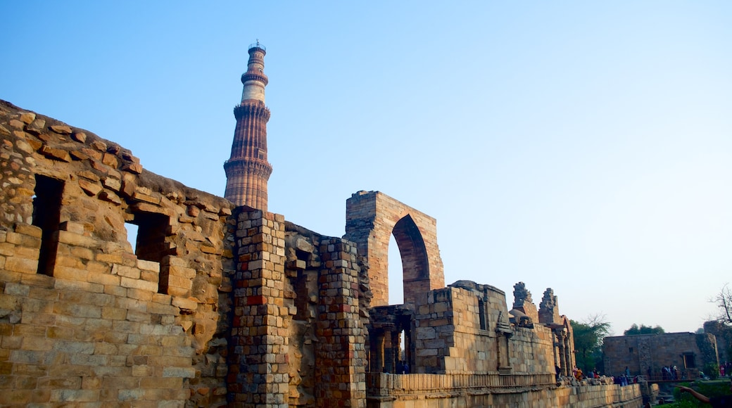 Qutub Minar showing heritage architecture and a ruin