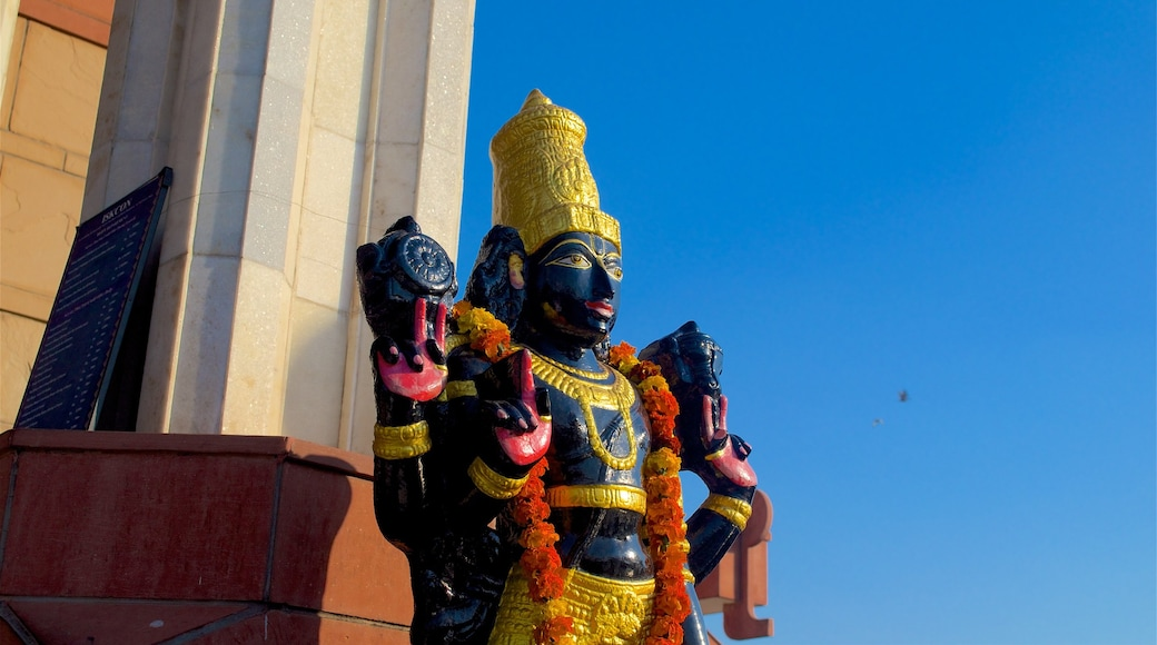 ISKCON Temple showing religious elements, a temple or place of worship and a statue or sculpture