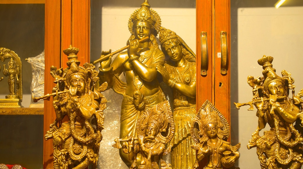 ISKCON Temple showing a statue or sculpture and religious aspects