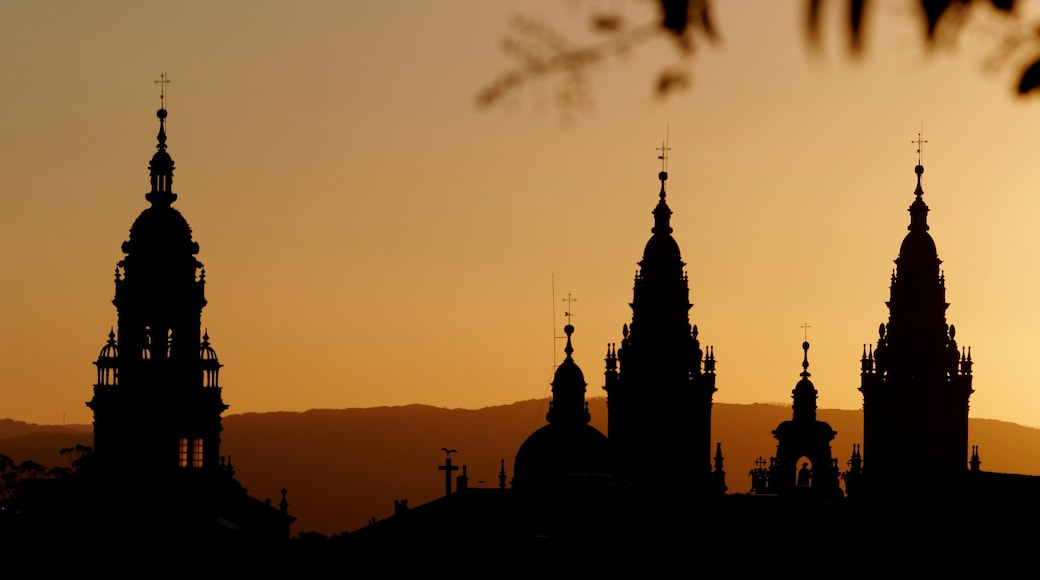 Santiago de Compostela featuring a church or cathedral, religious elements and a sunset