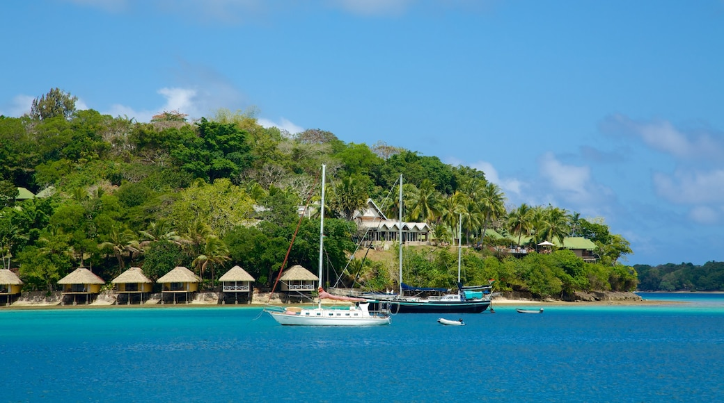 Iririki Island featuring general coastal views, tropical scenes and a small town or village