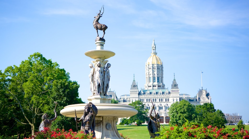 Bushnell Park which includes a statue or sculpture and a park