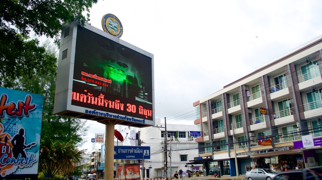 Krabi Town featuring signage, a city and street scenes