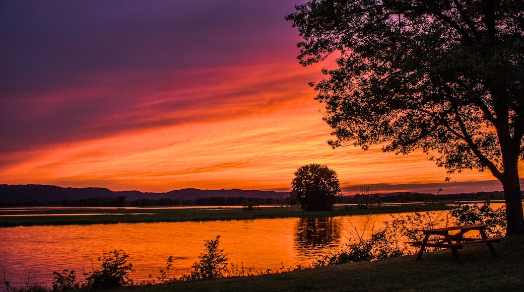 La Crosse which includes a lake or waterhole and a sunset