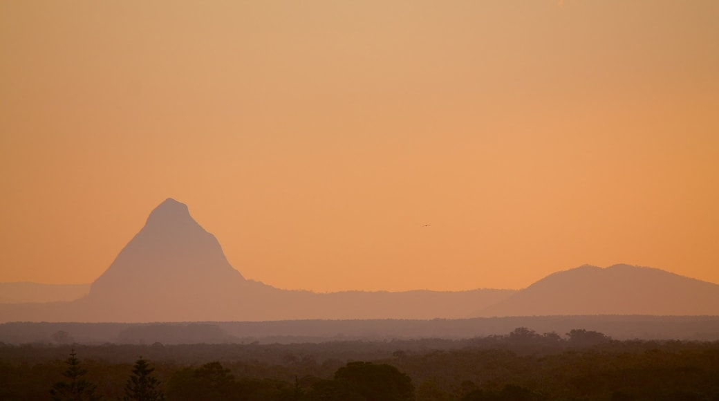 Glasshouse Mountains National Park showing mountains, landscape views and a sunset
