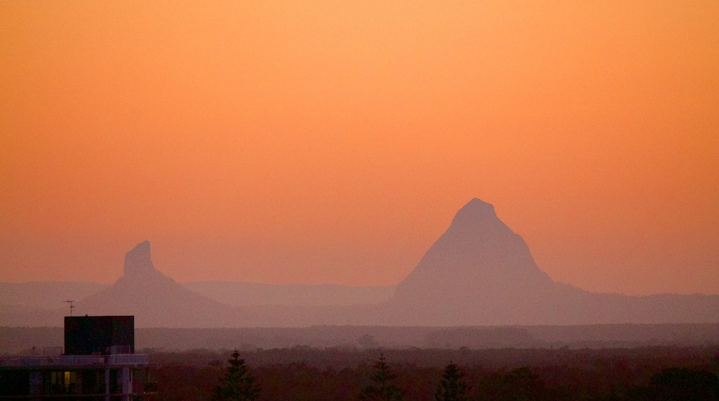 Glasshouse Mountains National Park which includes a sunset, landscape views and mountains