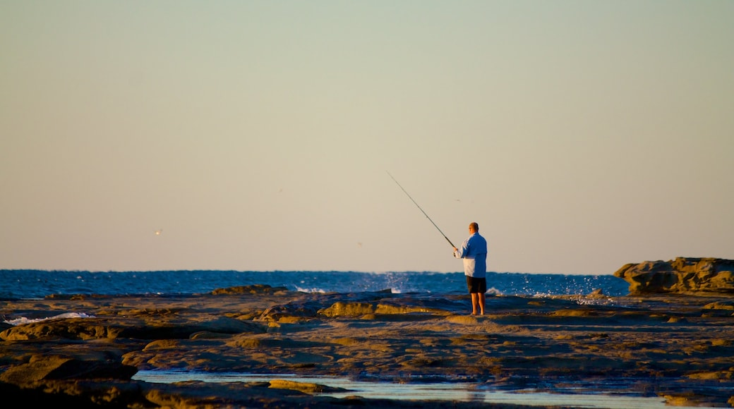 Shelly Beach featuring fishing and general coastal views as well as an individual male