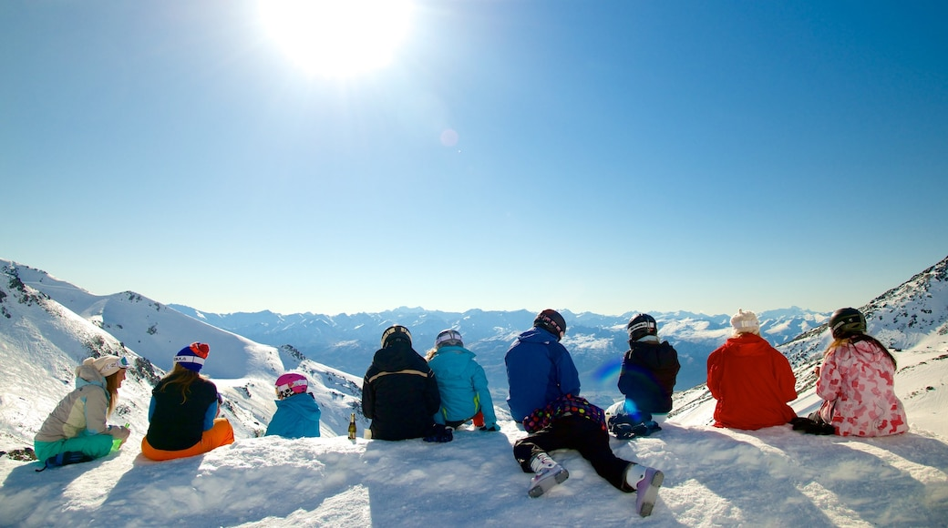 The Remarkables Ski Area showing snow as well as a small group of people