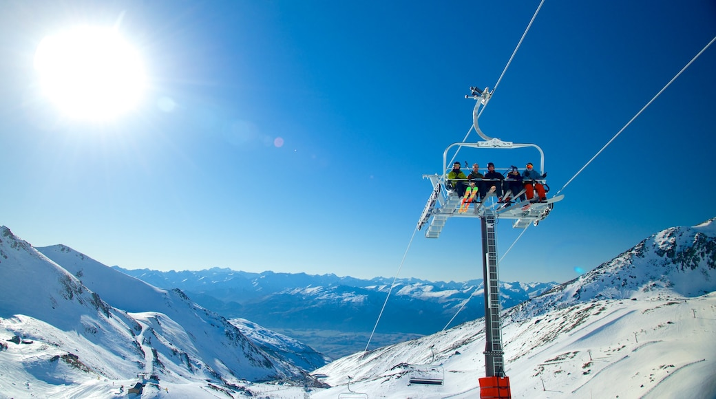The Remarkables Ski Area showing snow and a gondola as well as a small group of people