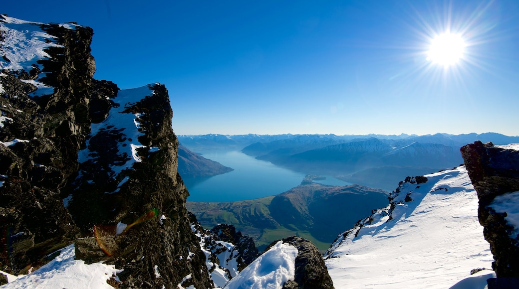 The Remarkables Ski Area showing a river or creek, snow and mountains