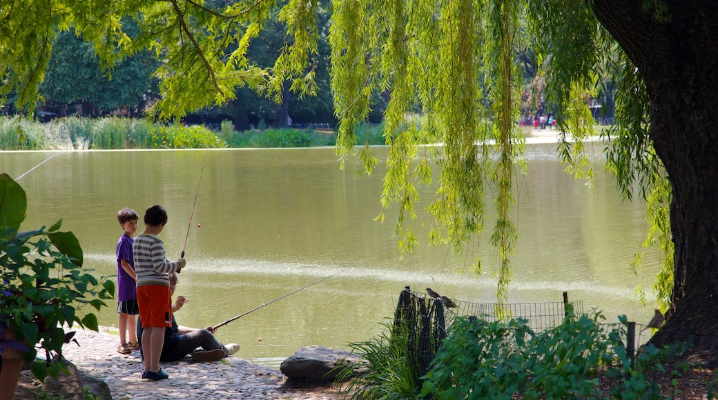Central Park featuring a lake or waterhole and fishing as well as children