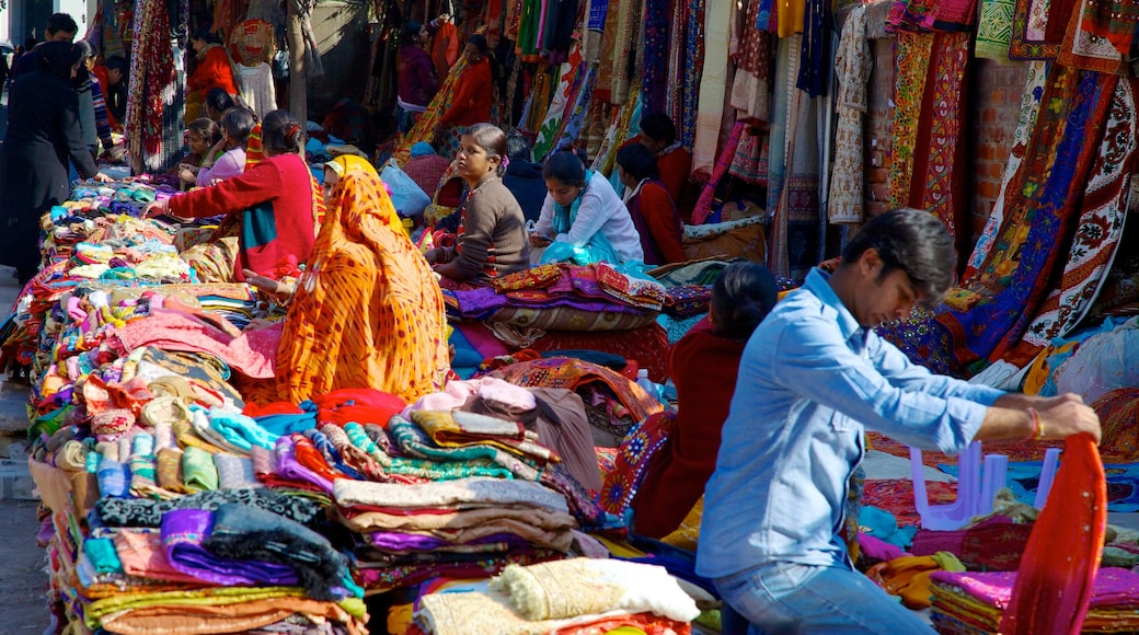 Delhi which includes shopping and markets as well as a small group of people