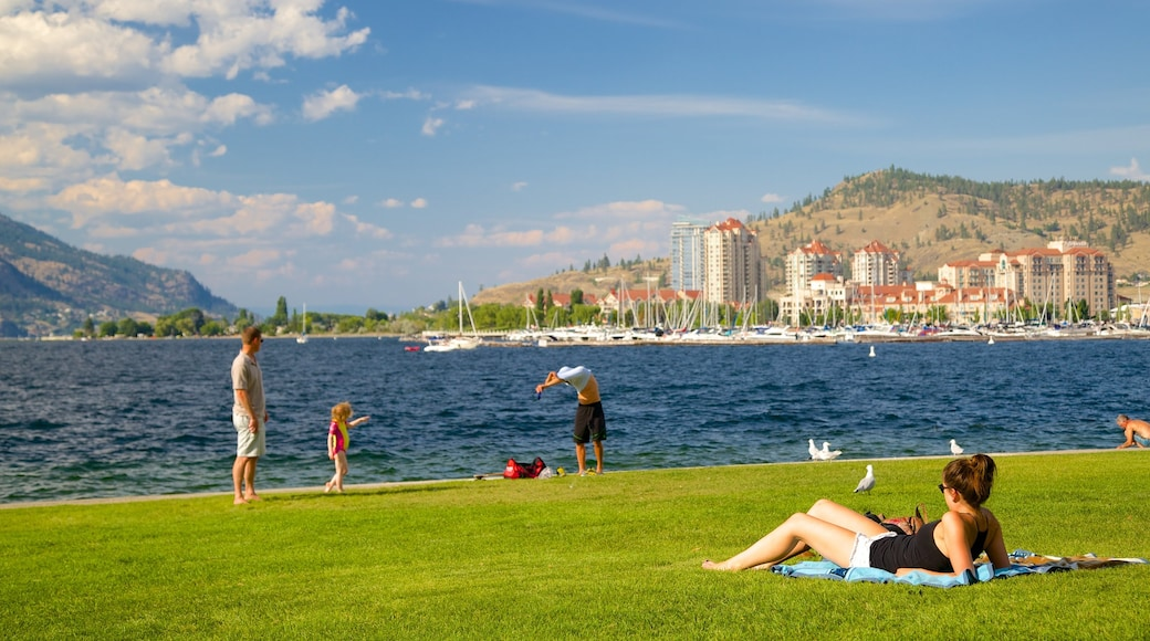 Kelowna which includes a garden and general coastal views as well as a small group of people