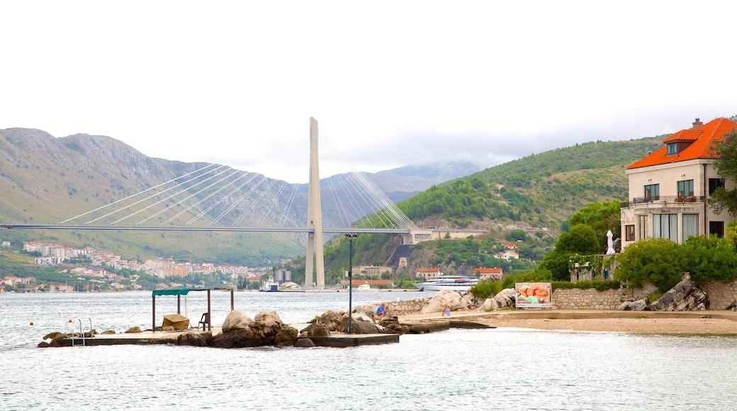 Copacabana Beach featuring a bridge, a sandy beach and a bay or harbor