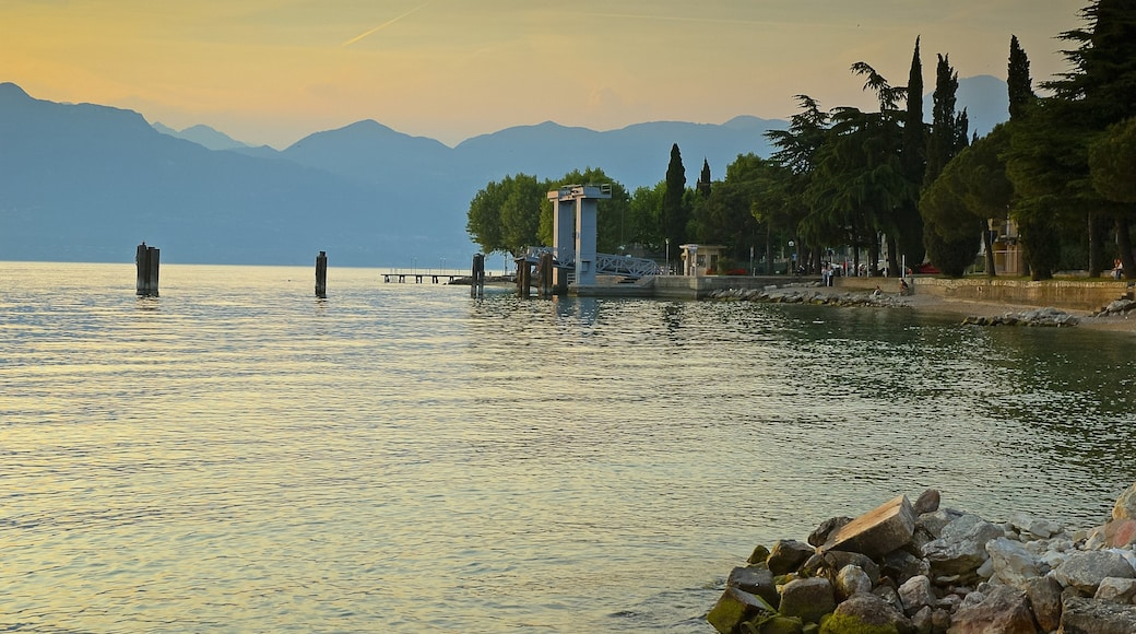Lake Garda showing landscape views, a bay or harbor and a sunset
