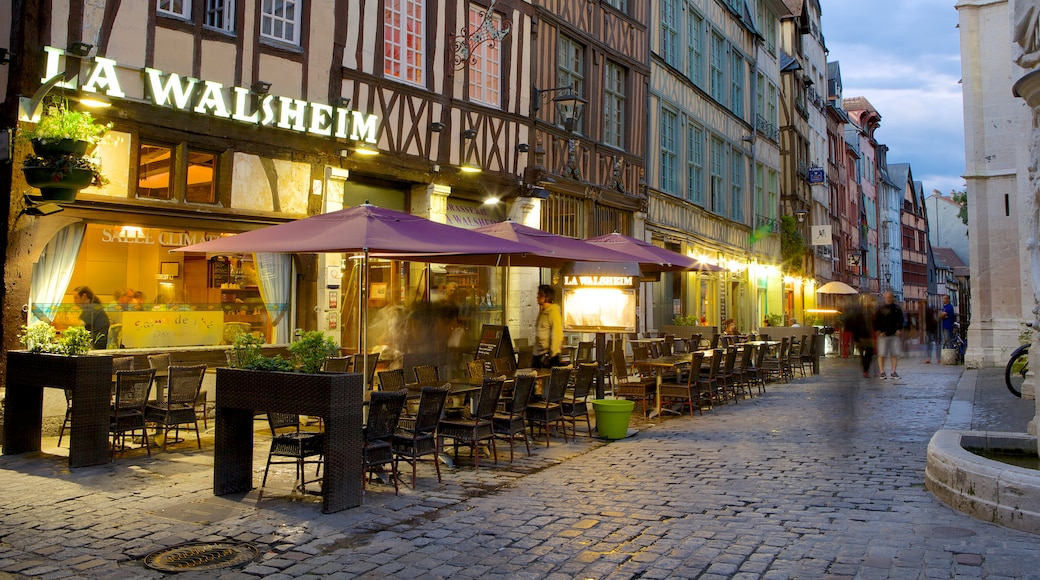 Rouen showing a small town or village, outdoor eating and night scenes