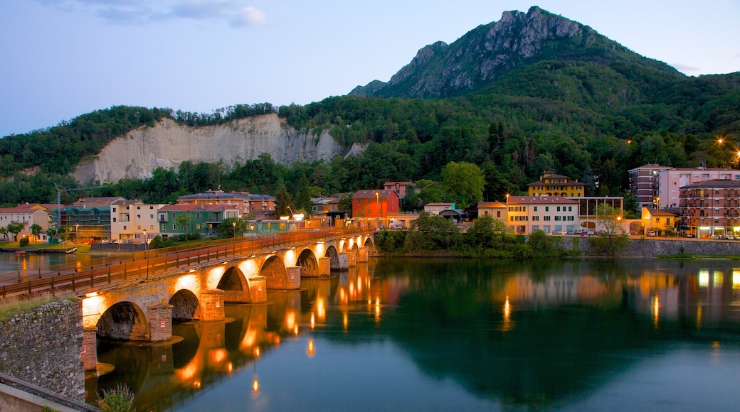 Lecco featuring night scenes, a bridge and mountains