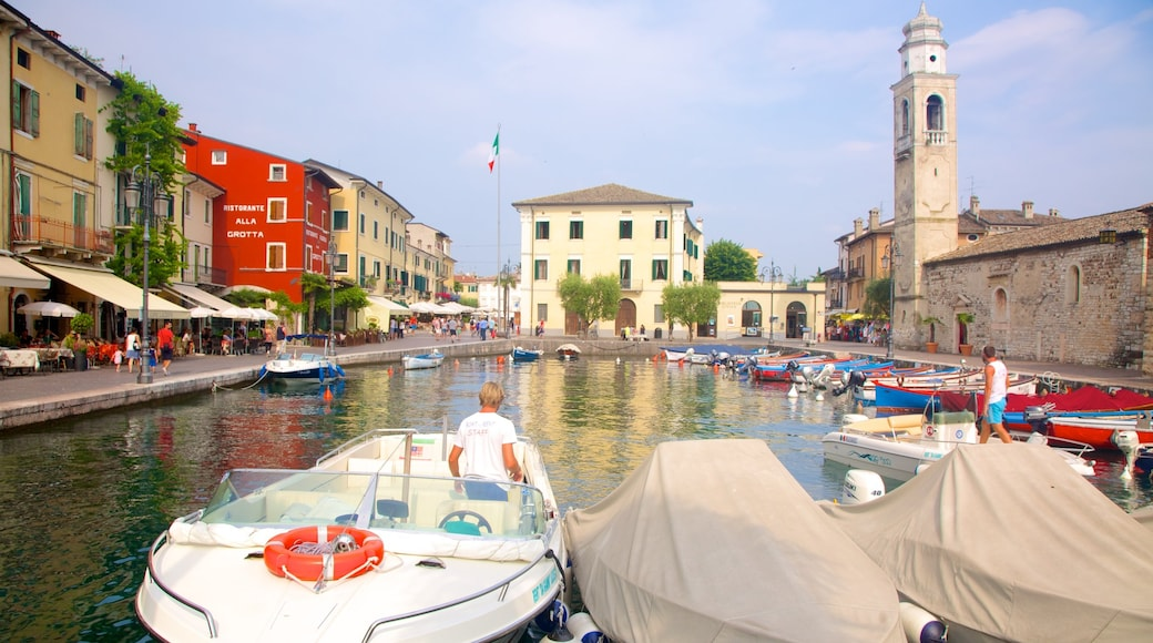 Lazise which includes a city, a river or creek and a marina