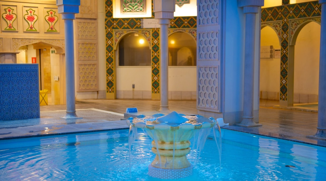 Spa World featuring interior views, a pool and a day spa