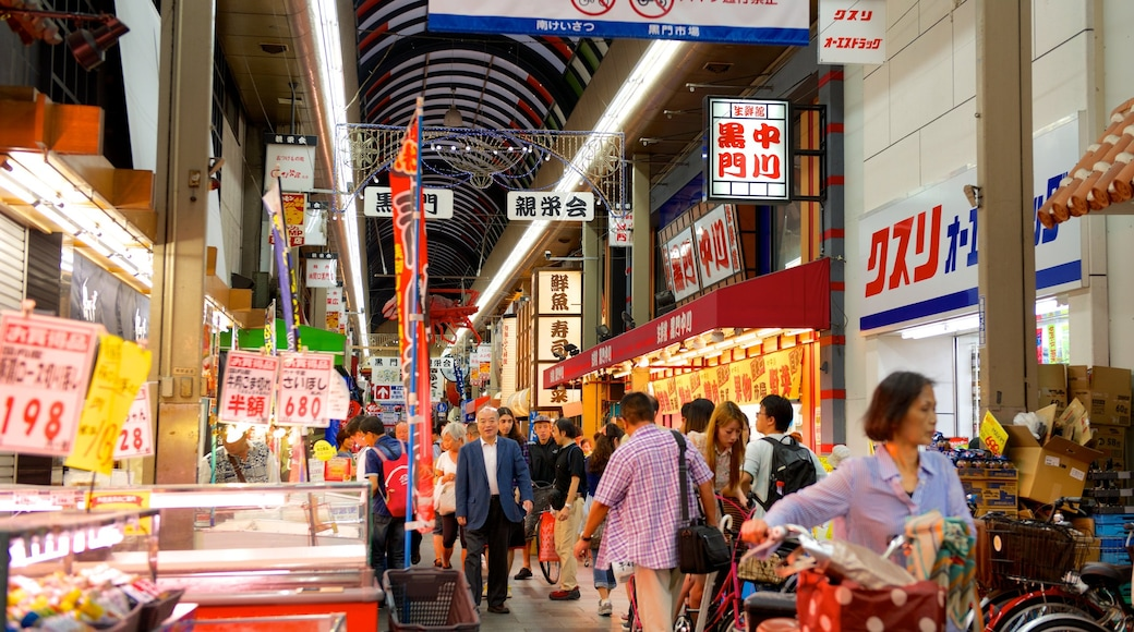 Kuromon Ichiba featuring interior views and a city as well as a large group of people