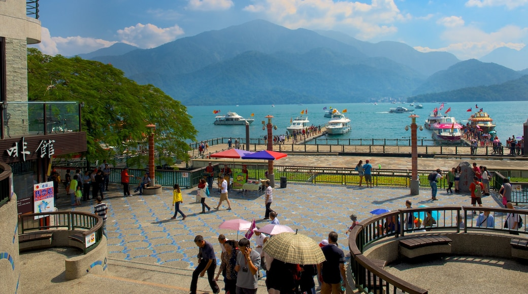 Shueishe Pier which includes a lake or waterhole as well as a small group of people