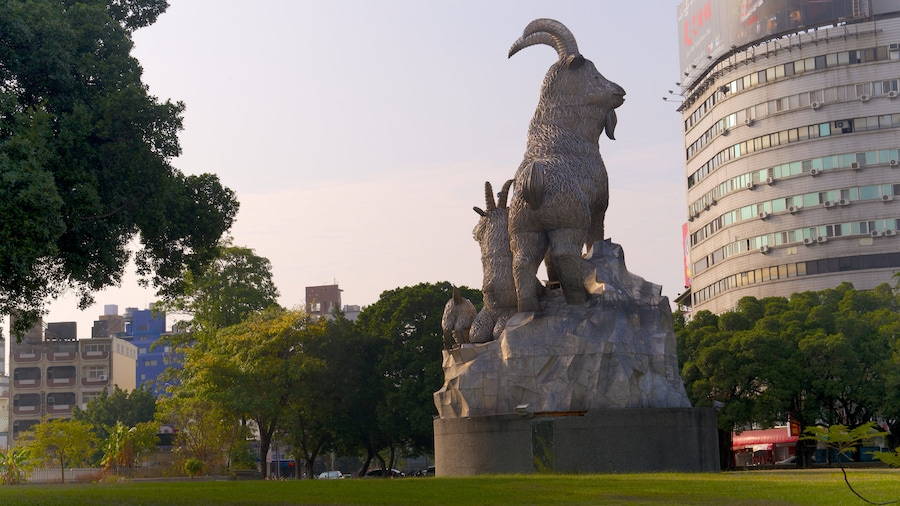 Taichung Park which includes a garden and a statue or sculpture