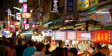 Liuhe Night Market showing a city, night scenes and markets