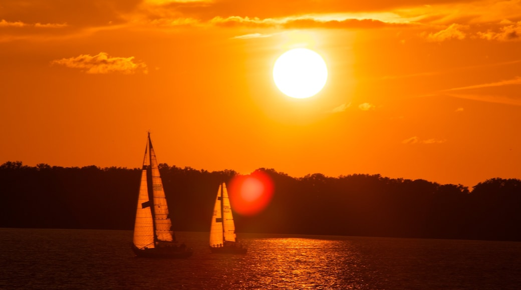 Erie which includes a sunset, a lake or waterhole and sailing