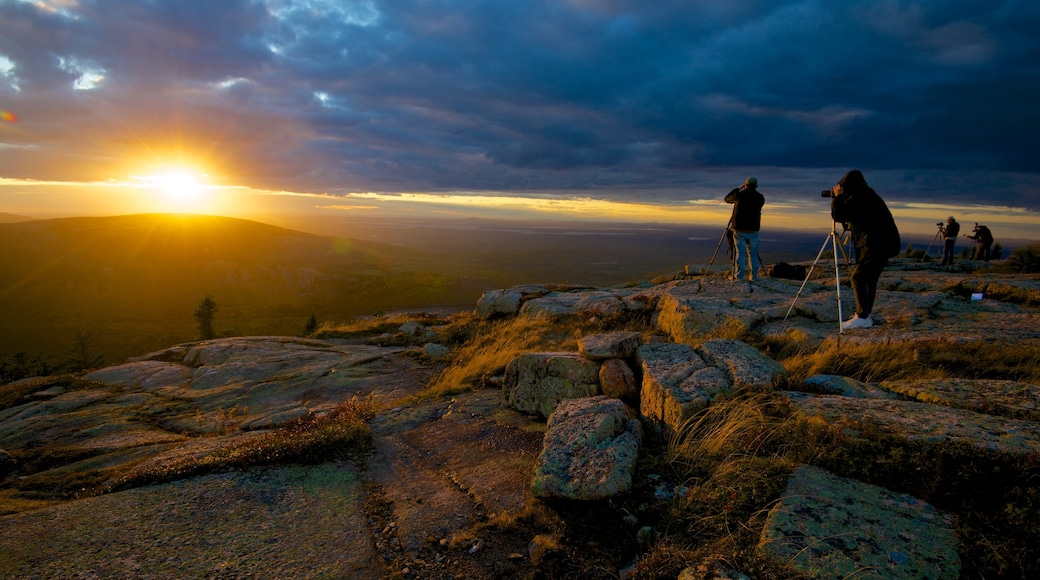 Cadillac Mountain which includes a sunset, landscape views and mountains