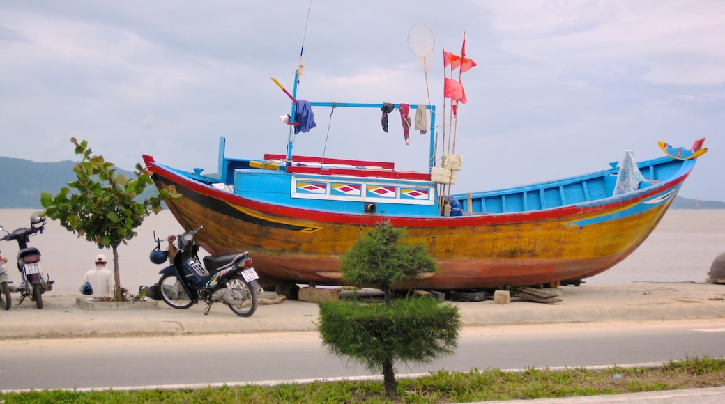 Nha Trang which includes general coastal views and a monument as well as an individual male