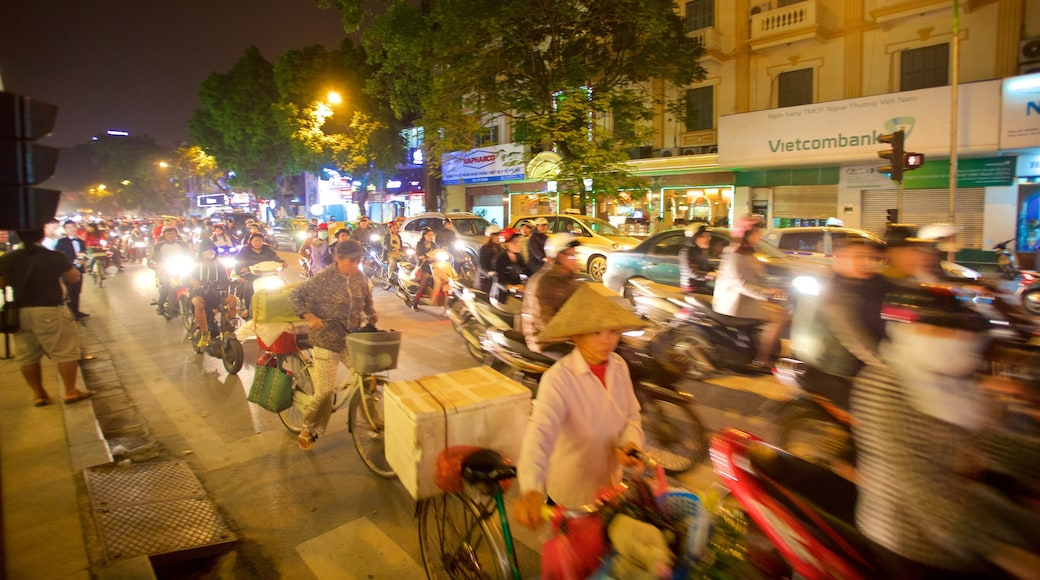 Hanoi featuring motorbike riding and street scenes