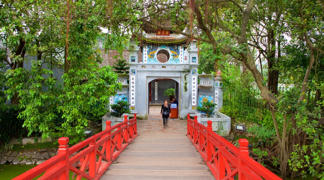 Ngoc Son Temple which includes a bridge as well as an individual female
