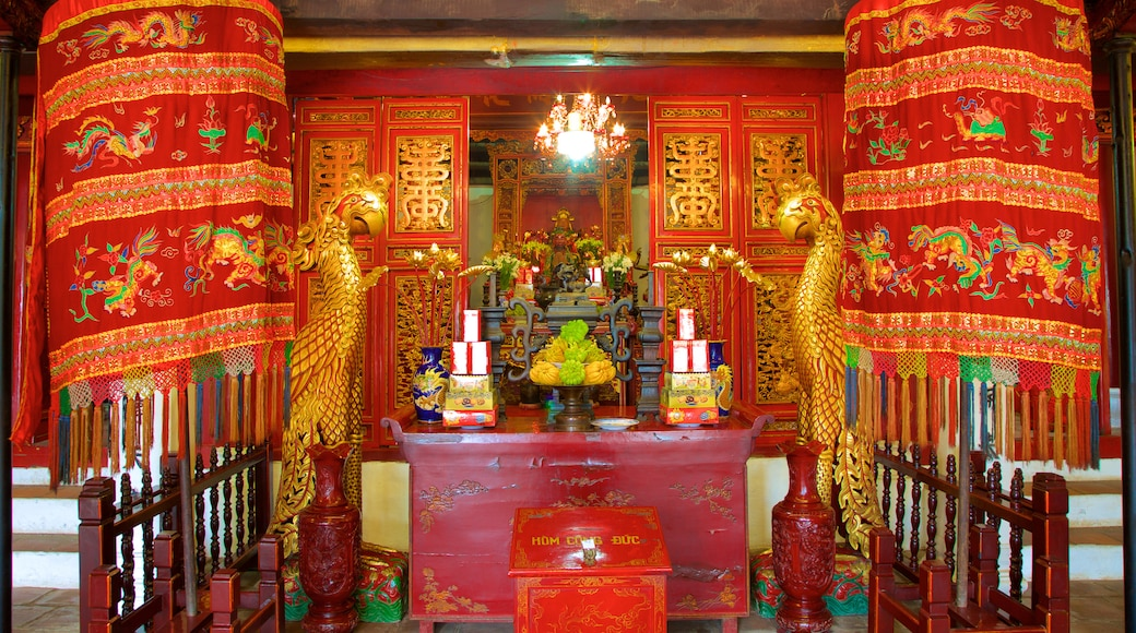 Ngoc Son Temple featuring religious elements, a temple or place of worship and interior views