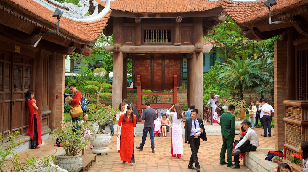 Temple of Literature showing a temple or place of worship as well as a large group of people