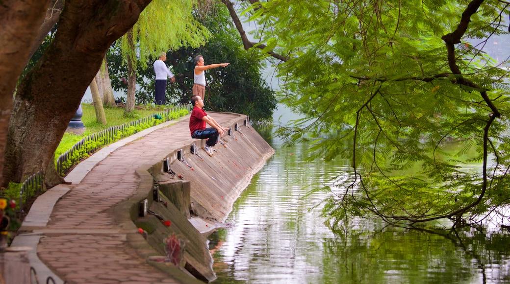 Hoan Kiem Lake showing a garden and a lake or waterhole
